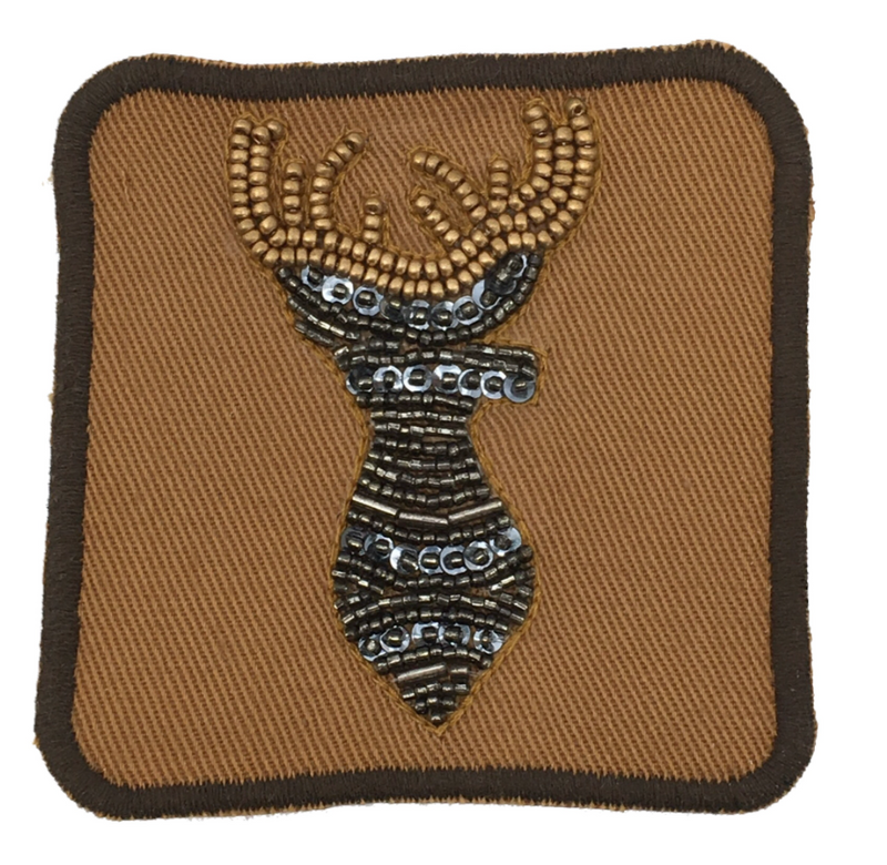 Judith March beaded deer patch on camouflage hat.