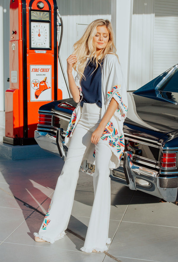 WHITE DENIM FLARE PANTS