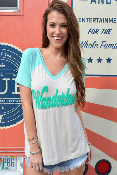 "JUDITH MARCH FLOWY RAGLAN SHORT SLEEVE TOP WITH ""WANDERLUST"" PUNCH NEEDLE"