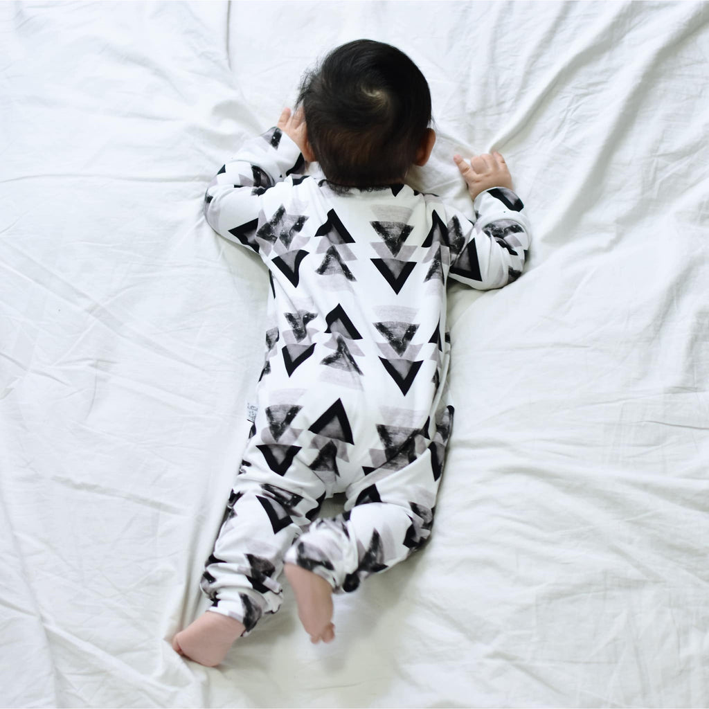 Monochrome baby and childrens clothing - front opening popper romper