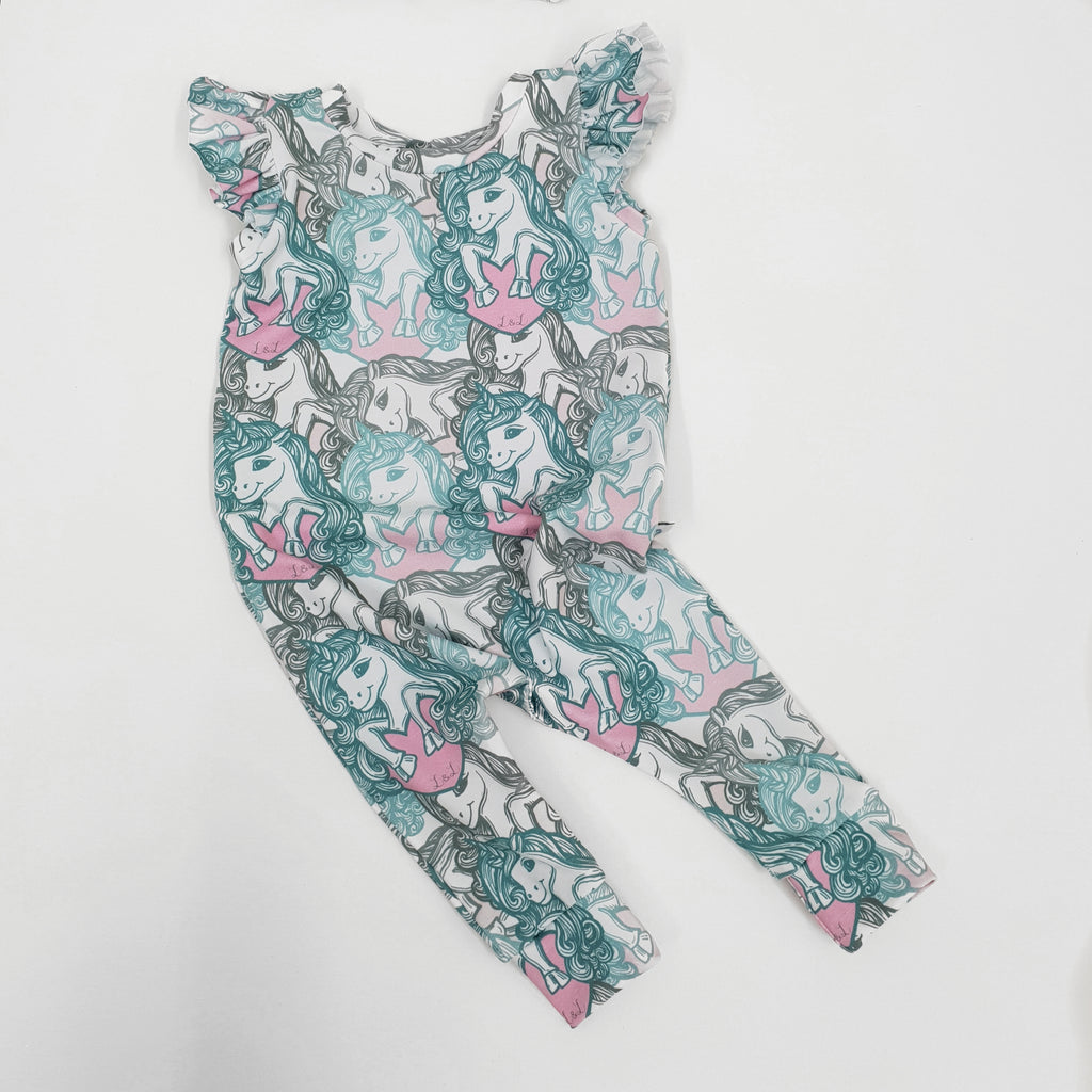 slip on baby and child romper with frill shoulder detail in organic unicorn print jersey by lottie and lysh