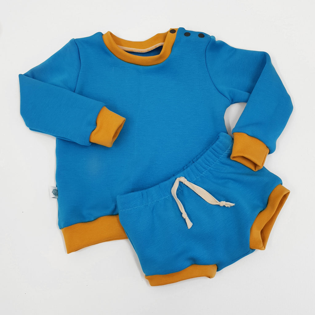 retro colourblok blue sweatshirt and matching bummies shorts with mustard trims