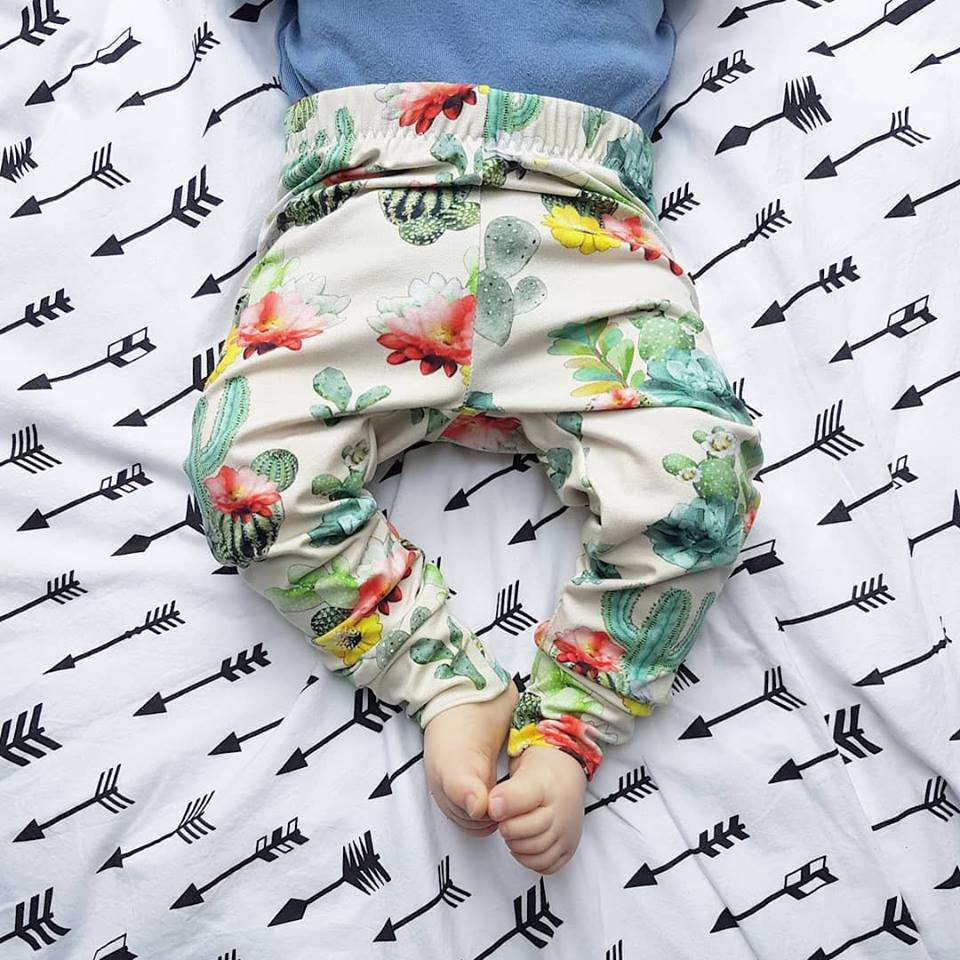 Cactus baby and toddler leggings paired with a blue vest. Handmade by Lottie & Lysh in Cornwall, UK