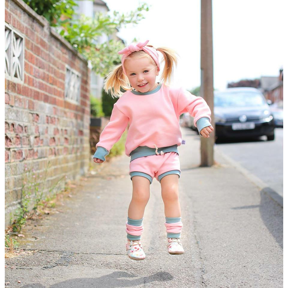 pink and olive shorts and sweatshirt set