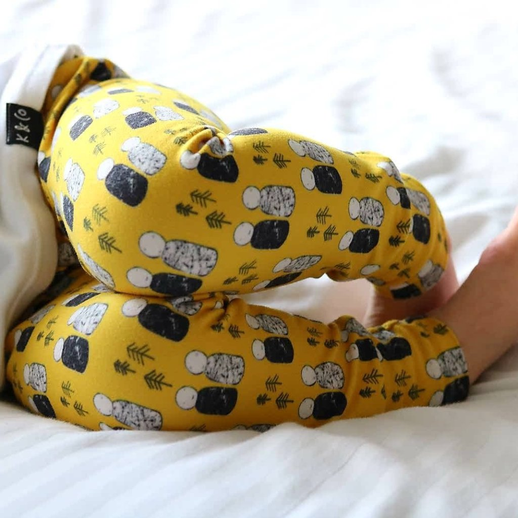 Mustard yellow unisex leggings with a monochrome peg doll design exclusive to Lottie & Lysh