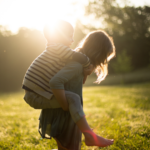 Two children playing in a garden for the feature images of Child-Safe Fencing