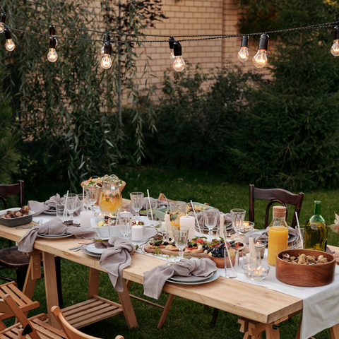 Garden Fence Lighting Options - Image shows outdoor seating with string lights