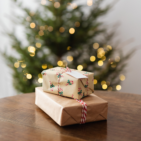 Gifts for Gardeners - Wrapped presents in front of a Christmas tree