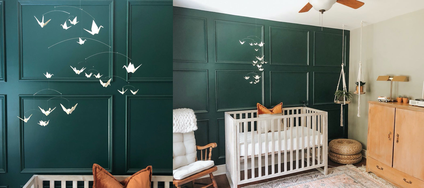 An all White Origami Paper Crane Mobile hangs above a white crib against a deep green nursery wall.