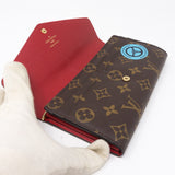 Sarah Wallet Monogram World Tour
