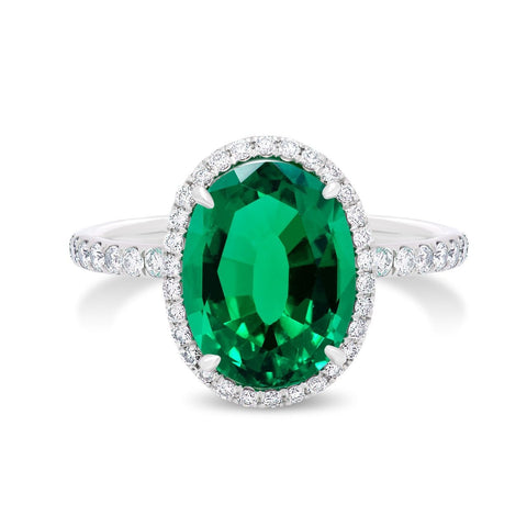 Platinum Oval Emerald and Diamond Halo Ring