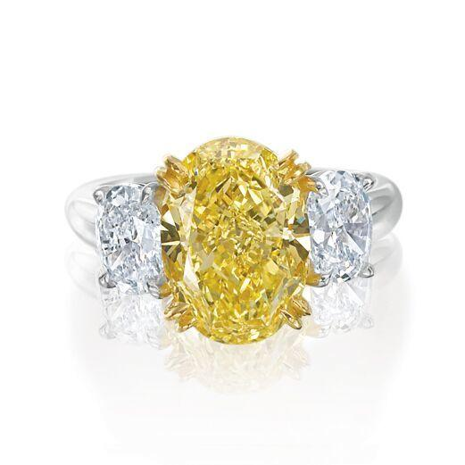 Oval Yellow and White Diamond Three Stone Engagement Ring