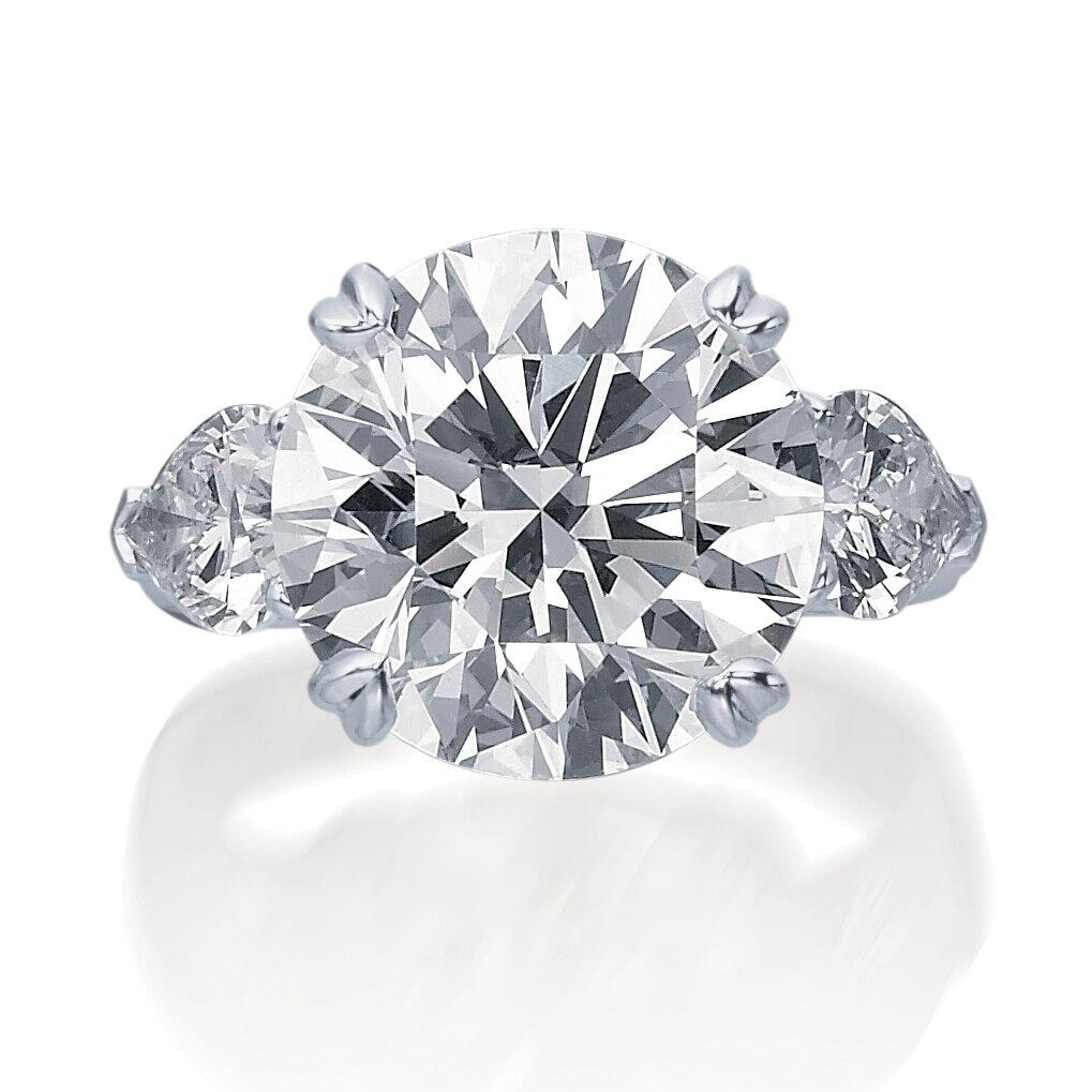Round Brilliant Cut Engagement Ring with Pear Side Stones