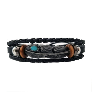 Native American inspired leather bracelet. Feather bracelet