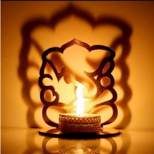 Shadow Ganesha Tealight Holder with a Tealight - auradecor.co.in