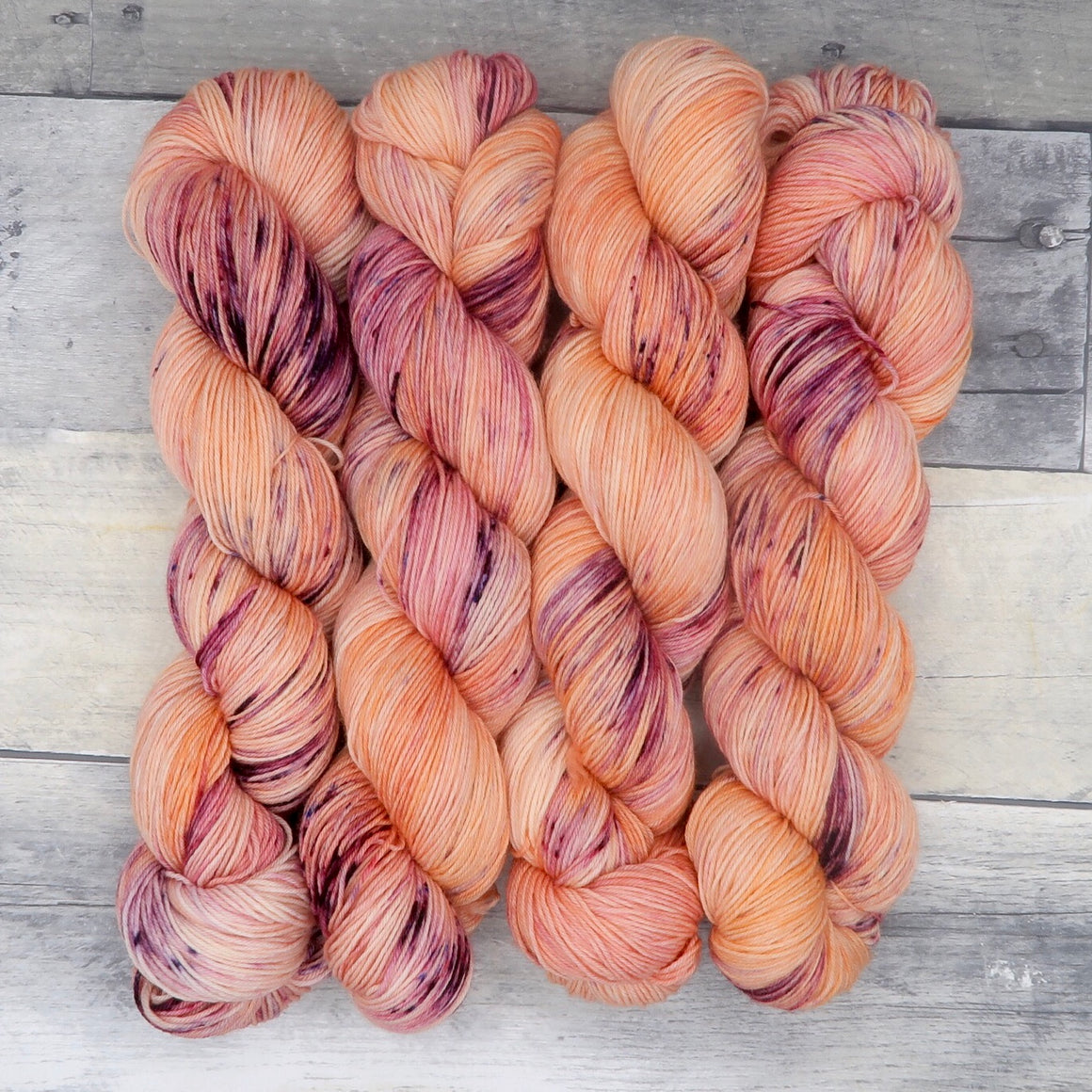 Dirigible Plums - (Everyday Sock - speckled) - peach and orange tonal with bold purple speckles
