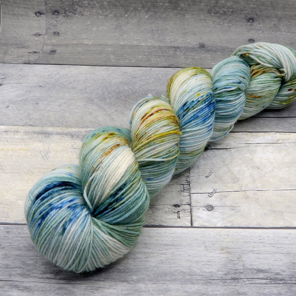 Happy Accident 1/31/19 - (Everyday Sock, speckled) - green-blue tonal speckeld with blue and earthy yellow