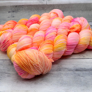 Electric Cantaloupe - (Everyday Sock, variegated/speckled) - vibrant and fluorescent orange-pink