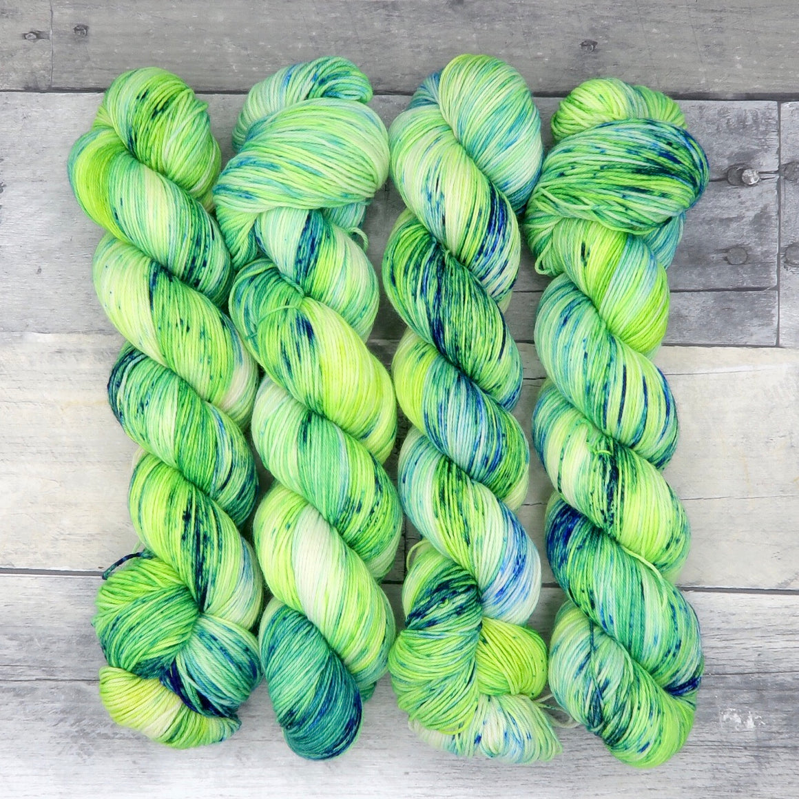 Sour Apple - (Everyday Sock, variegated/speckled) - vibrant and fluorescent green-yellow