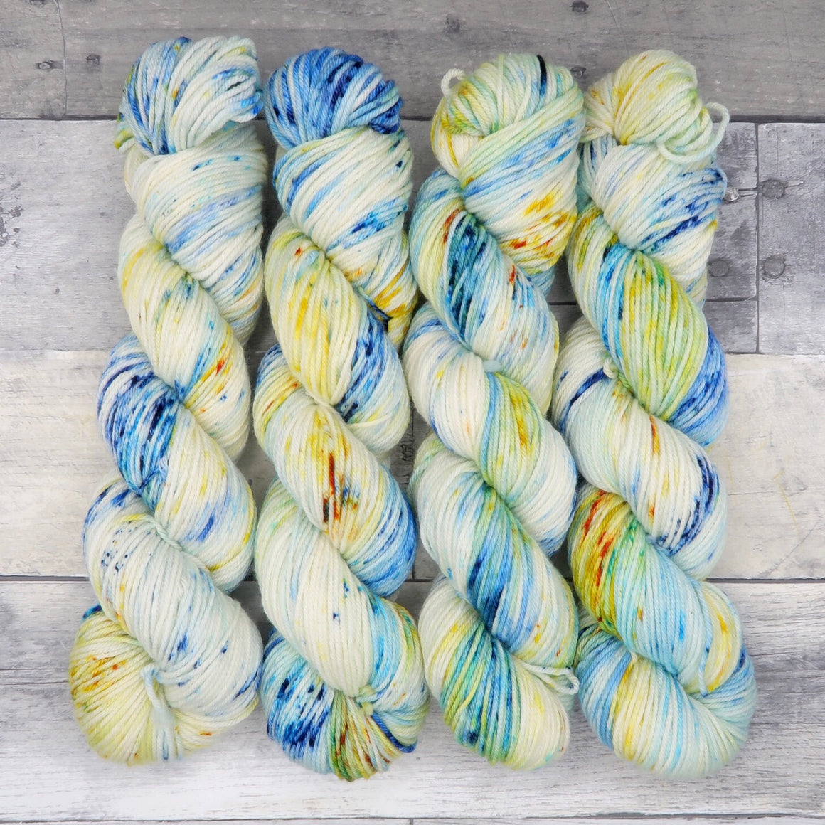 Mimblewimble (Merino DK, speckled variegated)- speckles of warm yellow and blue