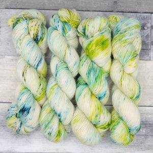 Reducto (Simple Sock, speckled variegated)- speckles of blue, green and teal