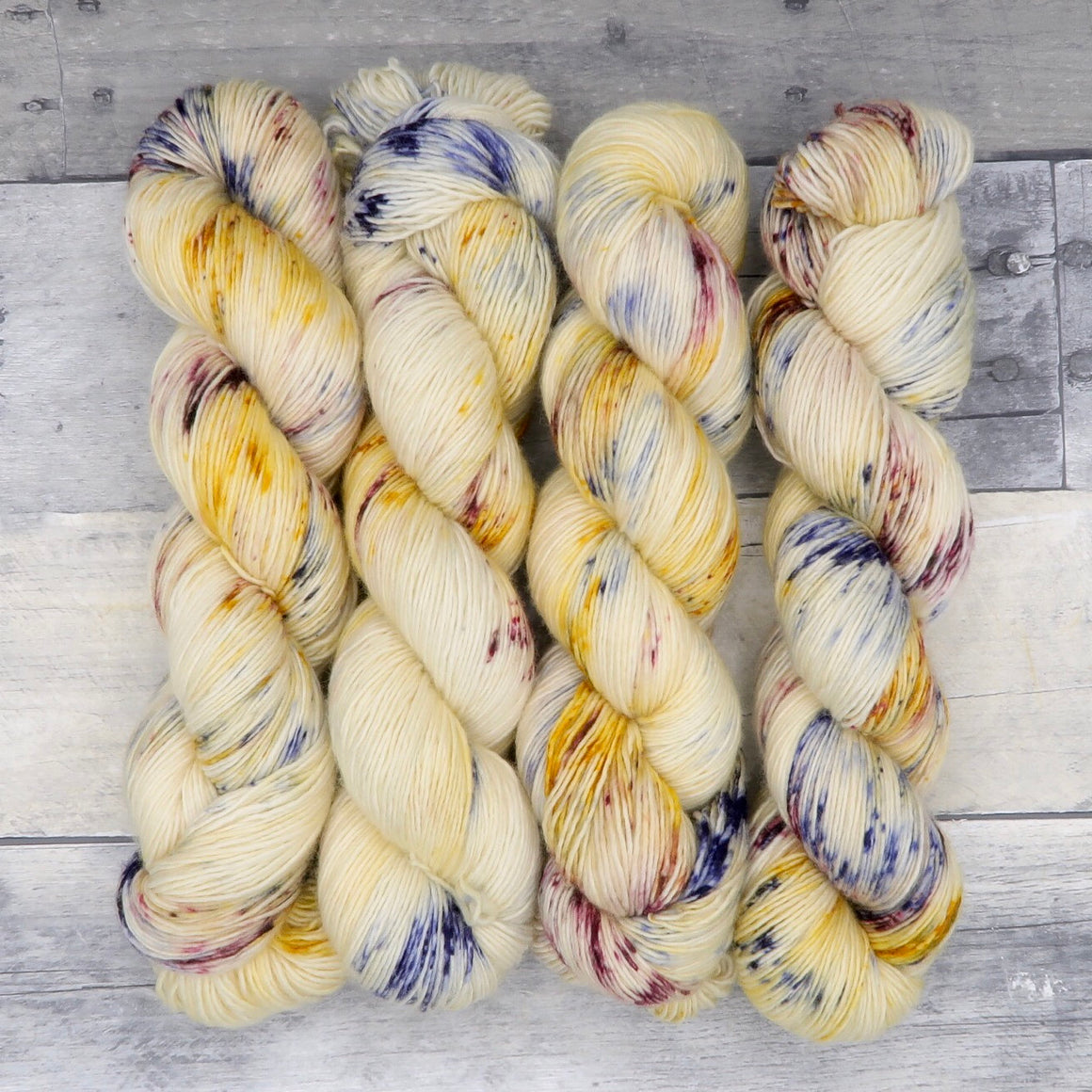 Lav-Lav - (Simple Sock, speckled, variegated) -  speckled mauve, navy, and warm yellow