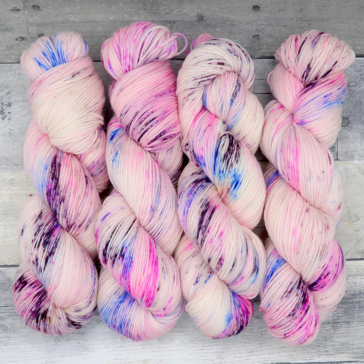 Fizzing Whizbees (Luxe Sock, speckled)- fluorescent pink, with speckles of cool blue and dark purple