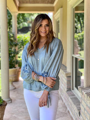 PLEASANTLY SURPRISED CHAMBRAY TOP
