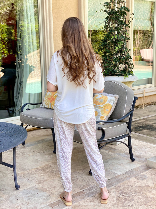 ONCE BITTEN SNAKE PRINT JOGGERS