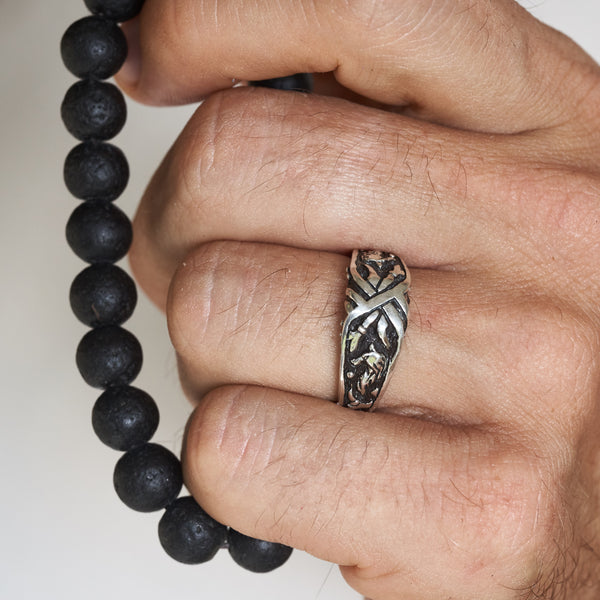 "Men's wedding band ""Wolf"" on a man's hand"