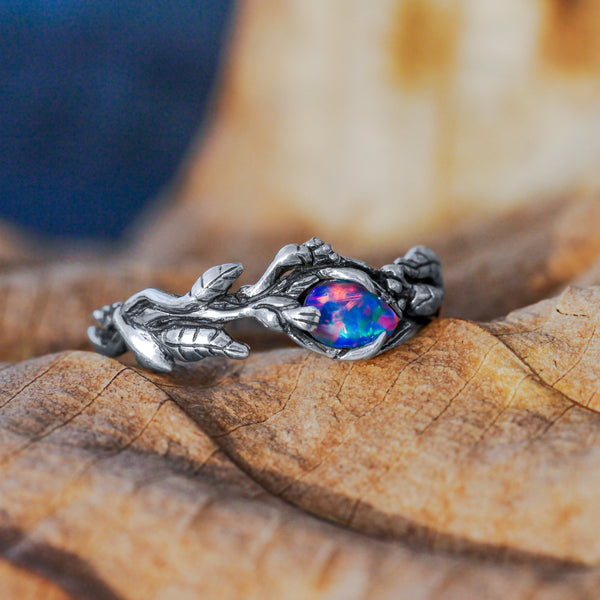 Boulder Fire Opal ring made out of Silver