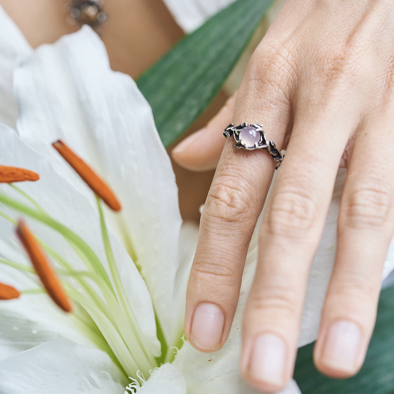 Rose Quartz engagement ring on the hand
