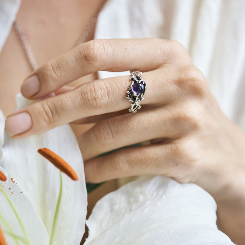 Amethyst engagement ring on the hand