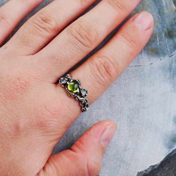 "Peridot and Opals ring ""Angie"" on the hand"