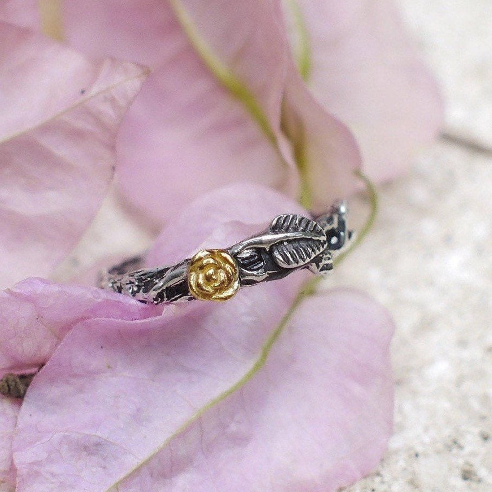 Sterling Silver wedding band with 14K Gold Rose