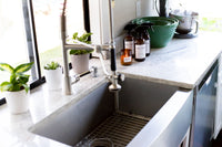 Kitchen sink with Vida Verde Home candles and sprays
