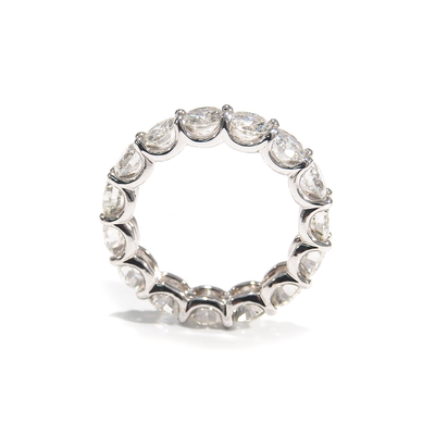 A lustrous Diamond Eternity Band. The comfortable U-Shaped design is adorned with sparkling Round Brilliant Cut Diamonds. Made For Love Jewelry. Boca Raton Florida