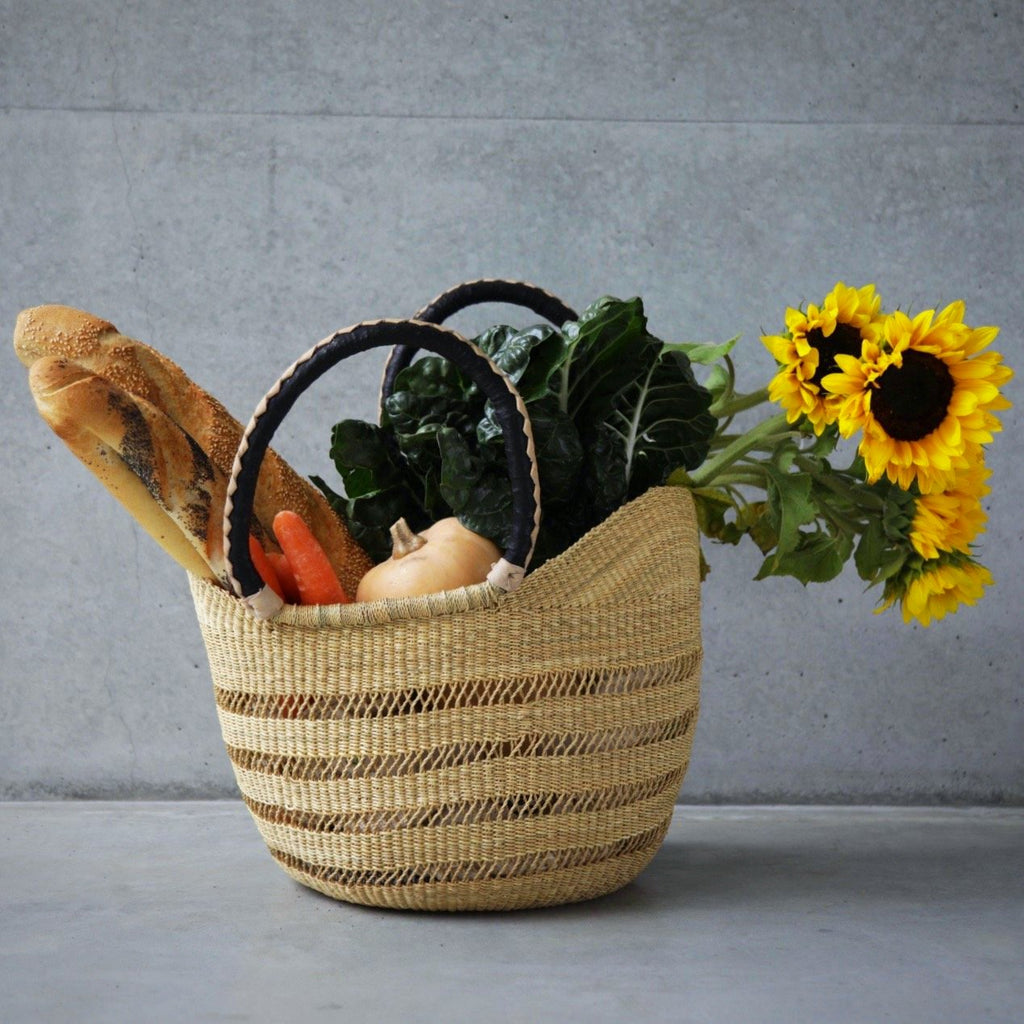 African Bolga Market Shopping Basket with natural open weave filled with fruit, vegetables, flowers and bread