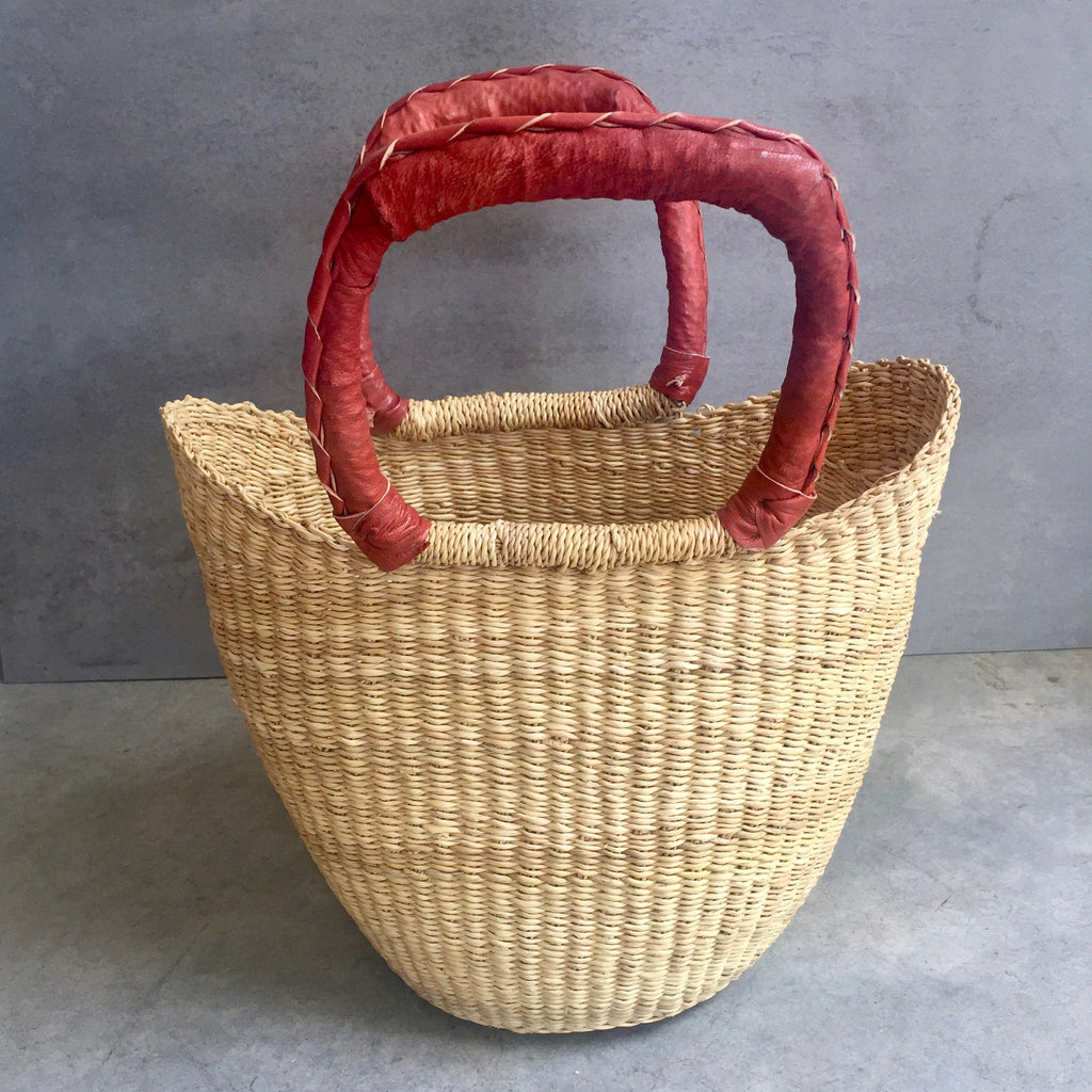 Mini African Bolga Market Shopping Basket with natural closed weave and leather handles.