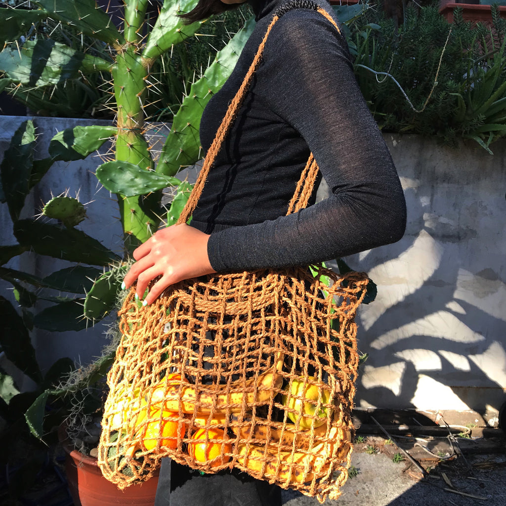 Model wearing Coconut Fibre String Bag from The Ekologi Store