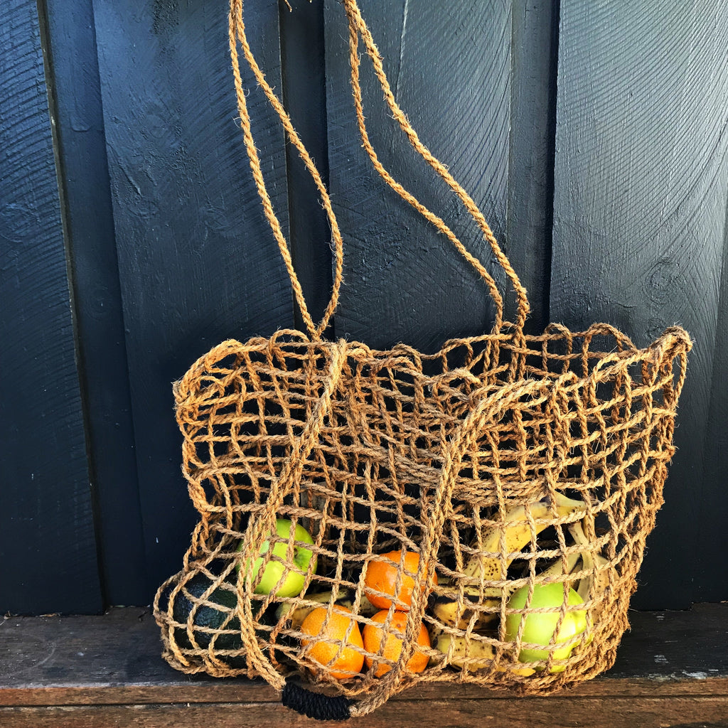 Coconut fibre string bag with vegetables