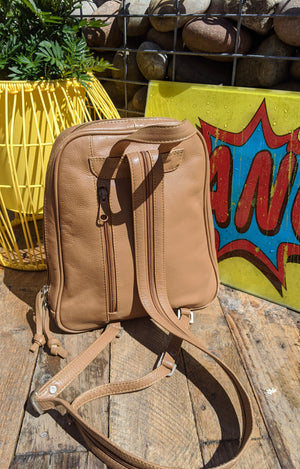 90s tan coloured backpack