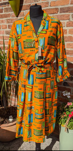 Orange patterned cotton dress size 12/14