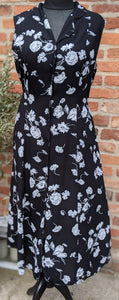 Sleeveless black and white 90s dress