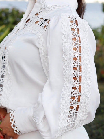 White long sleeve crochet blouse.