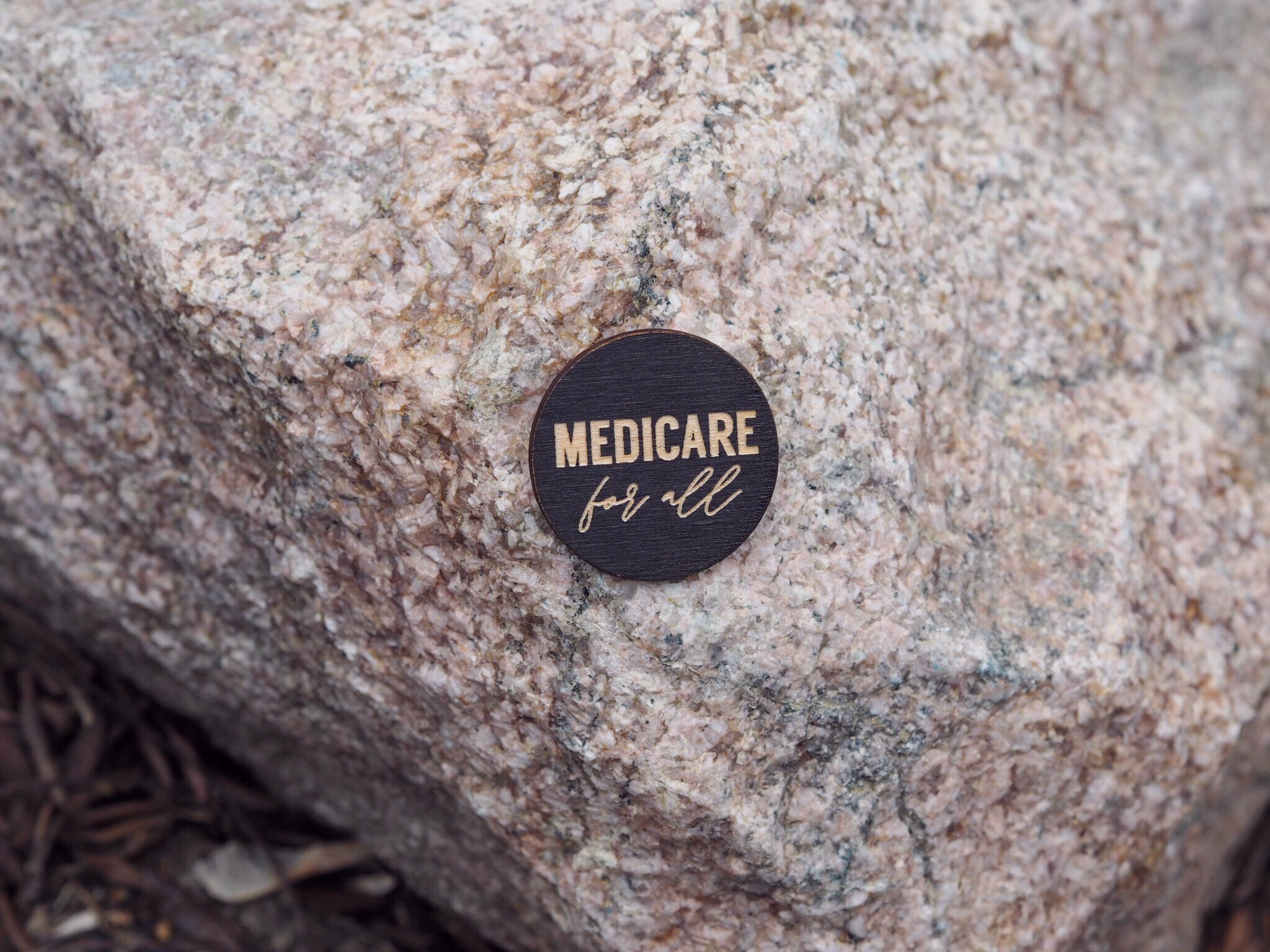 """Medicare for all"" button"