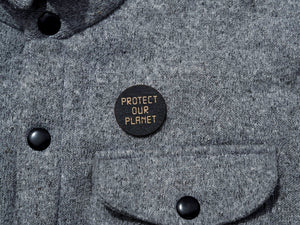 """Protect our planet"" button in black"
