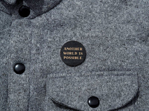 """Another world is possible"" button"