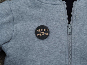 """Health is Wealth"" button"