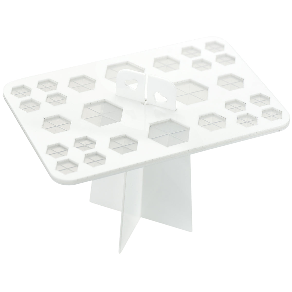 A white acrylic makeup brushes drying rack with 26 silicone holes in hexagon shape.